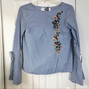 striped blue top with beautiful floral detail